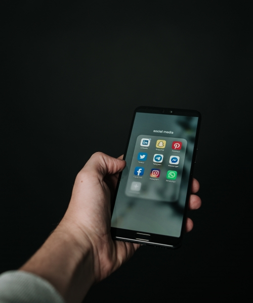 photo-of-hand-holding-a-black-smartphone-2818118